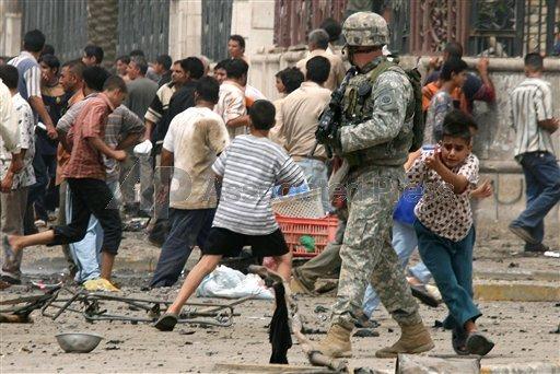 Iraqi Boy Hides Behind US Soldier In Baghdad