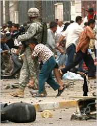 Iraq Boys Hides Behind US Soldier