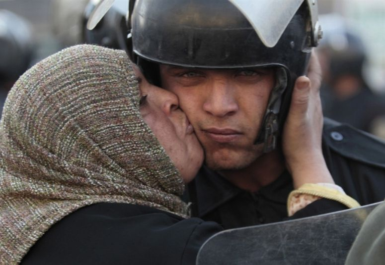 Protester Kisses Police During Egypt's 2011 Protests