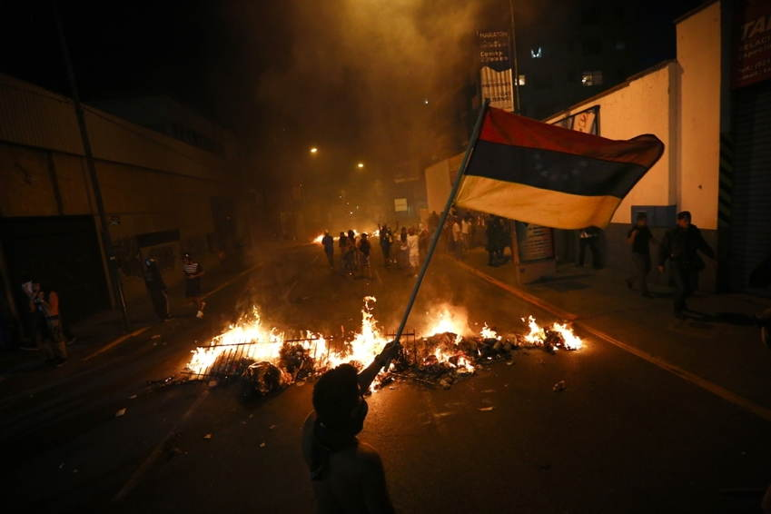 Venezuela Protests Fire Flag