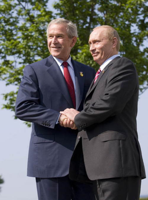 Putin Bush Holding Hands